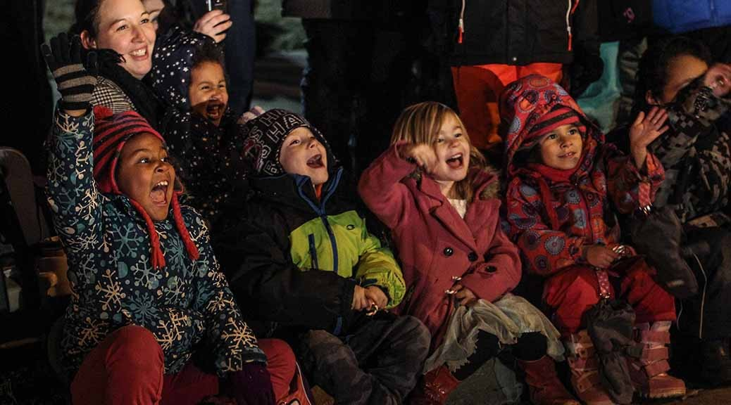 Kids watch the Parade of Lights. Photo by Barry Gray